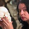 Forensic Artist Catyana Falsetti holding a human skull