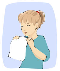 girl blowing on  paper