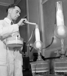 Scientist purifying penicillin, England 1943