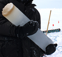 Researcher holding a piece of ice core.