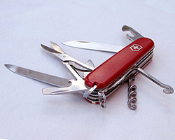 Swiss army knife with several of the tools unfolded.