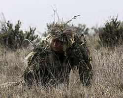 Soldier in a ghillie suit