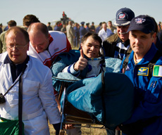 Astronaut getting carried after returning to Earth