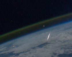 Shooting star photographed in low earth orbit by the ISS