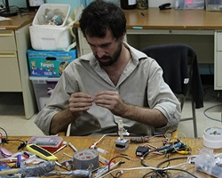 Peter Marting working on electronics for the Flick-o-matic