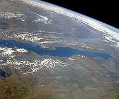 This is a photo of lake Tanganyika taken from a satellite. the lake runs from left to right across the middle of the image.