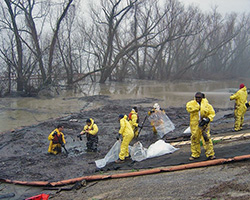 A team of people cleaning up a chemical spill