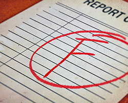 "A report card showing an ""F"" grade"