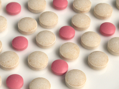 Pink and beige medical pills