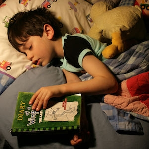 Picture of a child who fell asleep while reading Diary of a Wimpy Kid