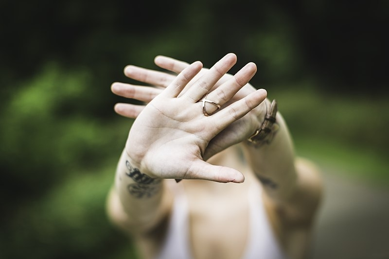 Hands hiding face - image by Drew Hays