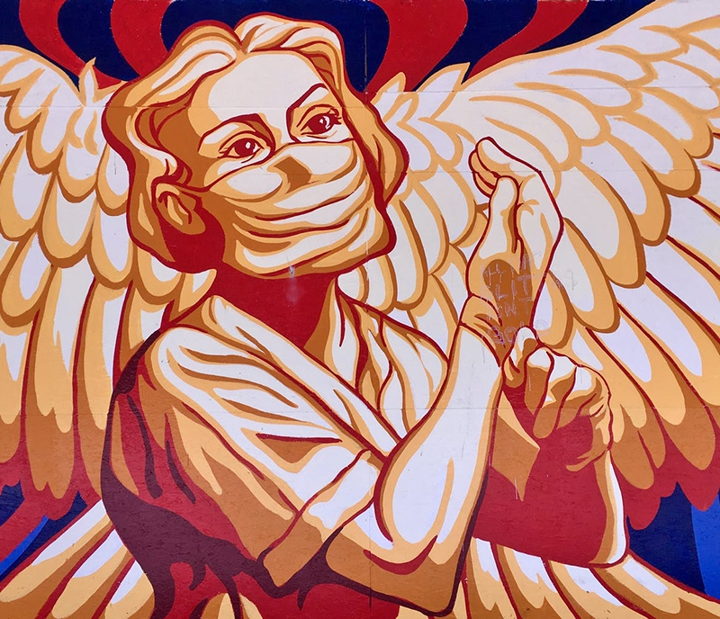 "Mural in Vancouver by Will Phillips of an ""angel"" healthcare worker during the COVID-19 pandemic"