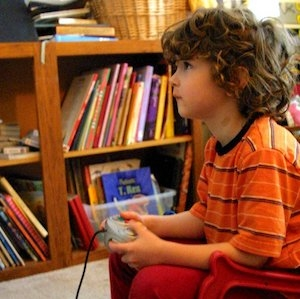 A young child playing video games