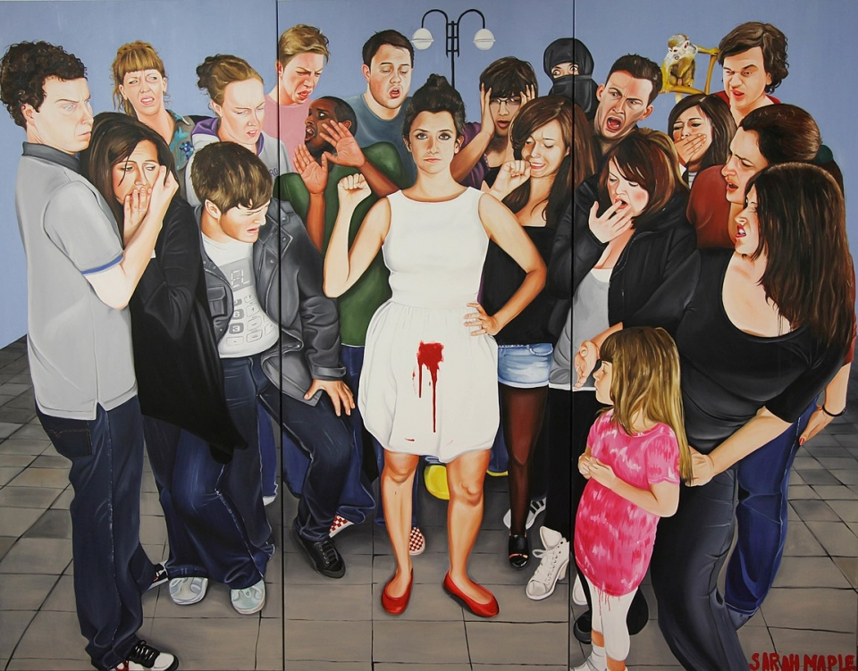 Art piece Menstruate with Pride by Sarah Maple; a variety of people all look at one woman who has a blood stain from her period on her white dress.