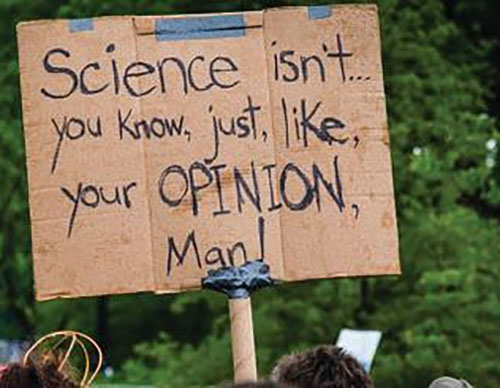 Handwritten cardboard poster - Science isn't you know, just like, your OPINION man!