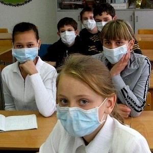 Children wearing masks to protect against airborne disease
