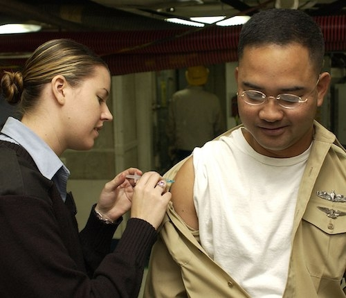 Vaccine being given to a Navy recruit